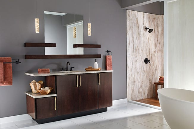 bathroom with dark walnut vanity, white countertops, white tile floor, soaker tub, and open shower