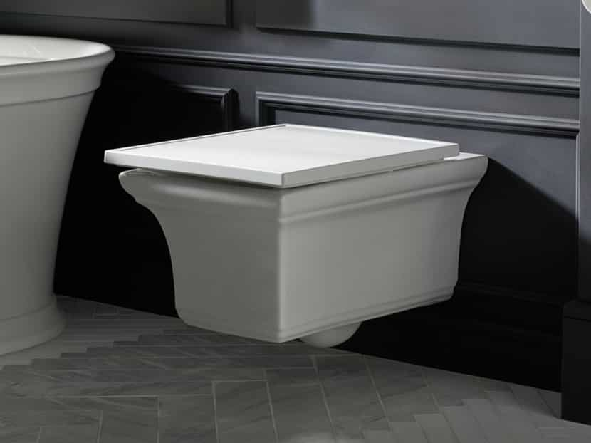 remodeled bathroom with a white Kohler wall-mounted toilet with rectangular shape
