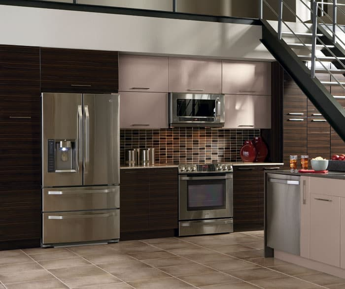remodeled condo kitchen with two-toned cabinetry, dark wood lower cabinets and light warm grey upper cabinets