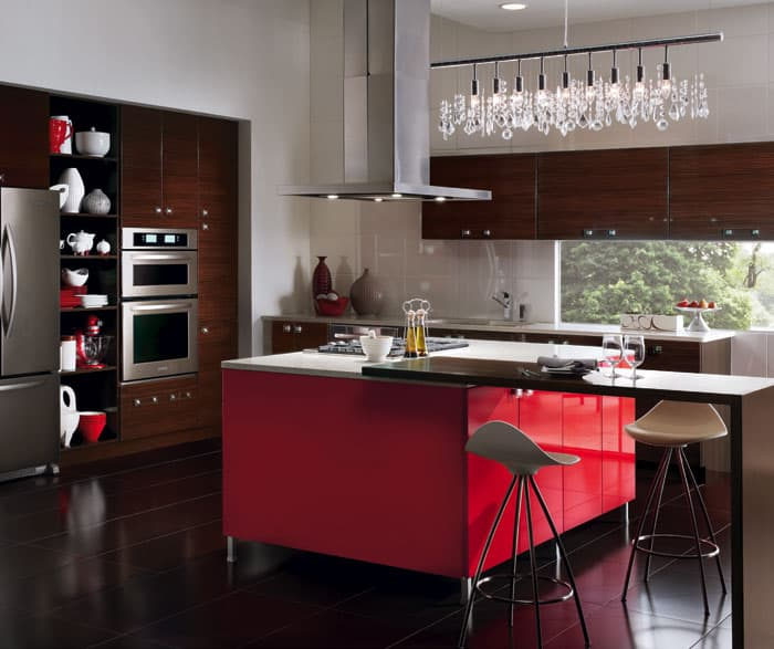 remodeled kitchen with two-tone cabinetry, red center island cabinets and dark wood cabinets elswhere