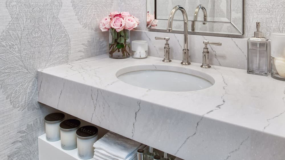 clean white and grey bathroom with veined quartz countertops